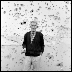 """Man in Front of Bullet Riddled Wall"" Vukovar, Croatia."